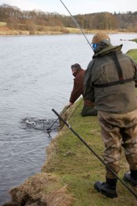FishPal's CEO Mark Cockburn netting a customers fish