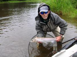 Middle Pavilion ghillie Mick Charlton safely returning a salmon caught by Graham Thomas on 27th July in a rising water